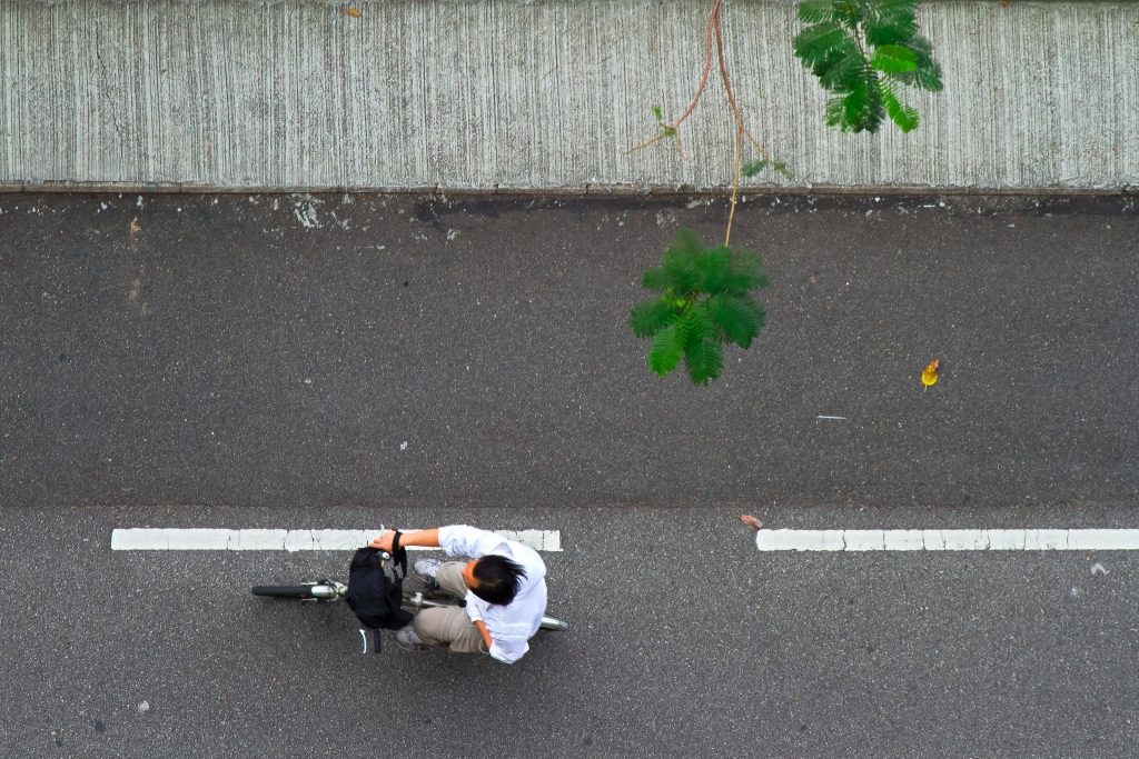 Overhead shot of a cyclist on a Hong Kong Street. (Image by See-ming Lee)