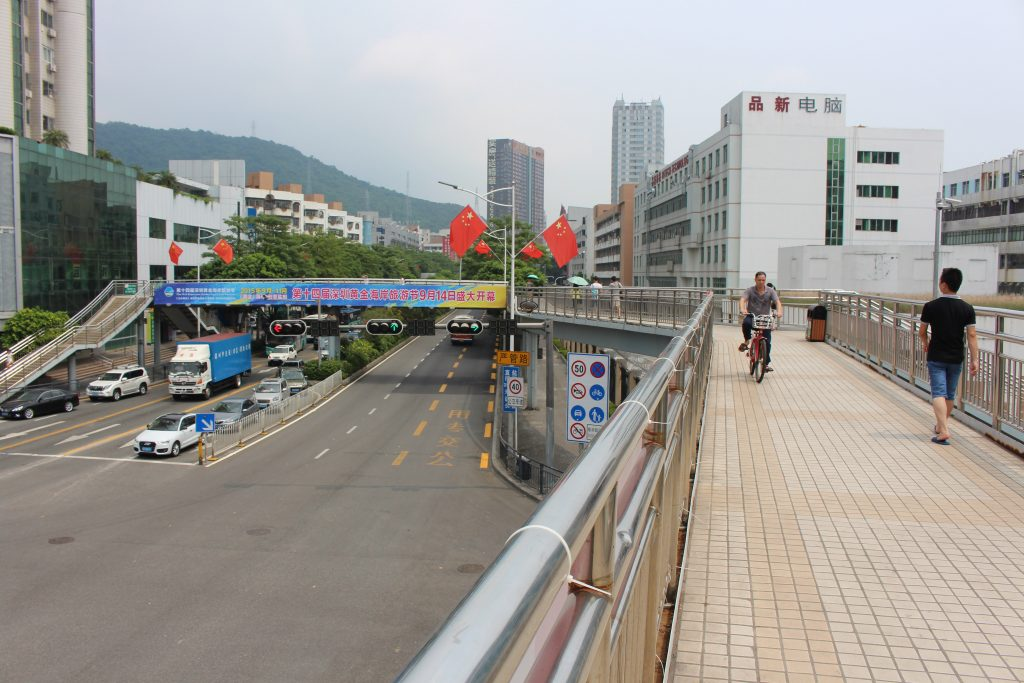 Shenzhen's large roads often force cyclists to use pedestrian walkways to get around. (Image by Charlie Palmer)